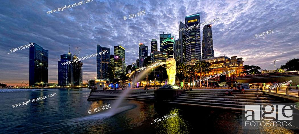Stock Photo: Singapore skyline and Merlion statue in evening twilight, viewed from Merlion Park, Singapore.
