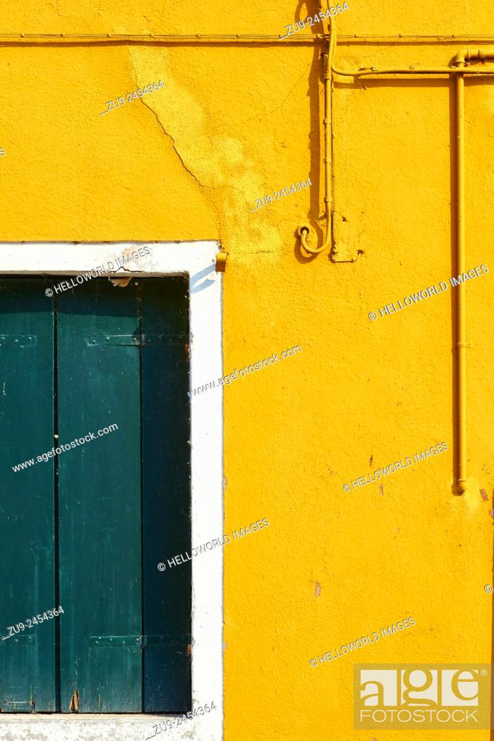 Stock Photo: Yellow wall with pipes, wires and green shutters, Burano, Venetian Lagoon, Veneto, Italy, Europe.