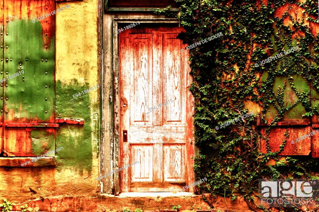 Stock Photo: An old wooden door on an old building in an alley way.