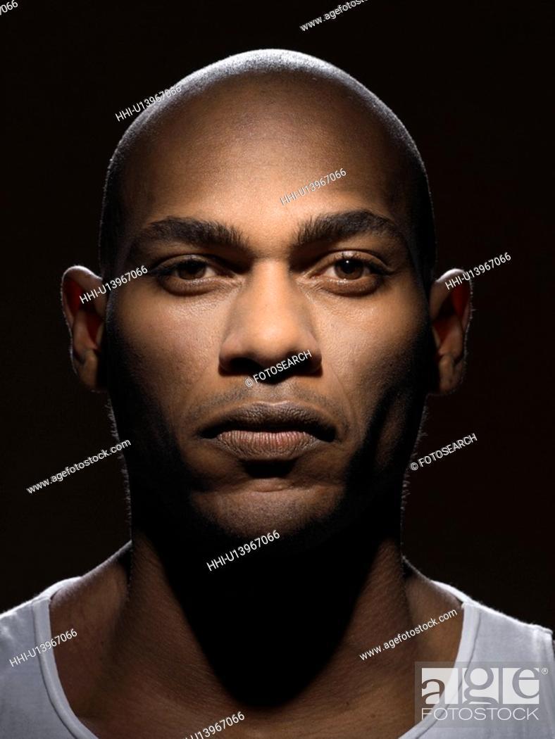 Stock Photo: Confident young man (portrait).
