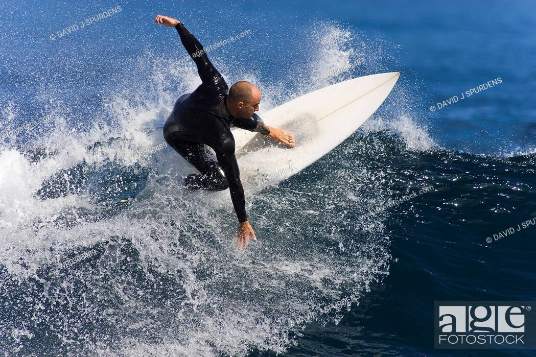 Stock Photo: Balanced surfer carving wave.