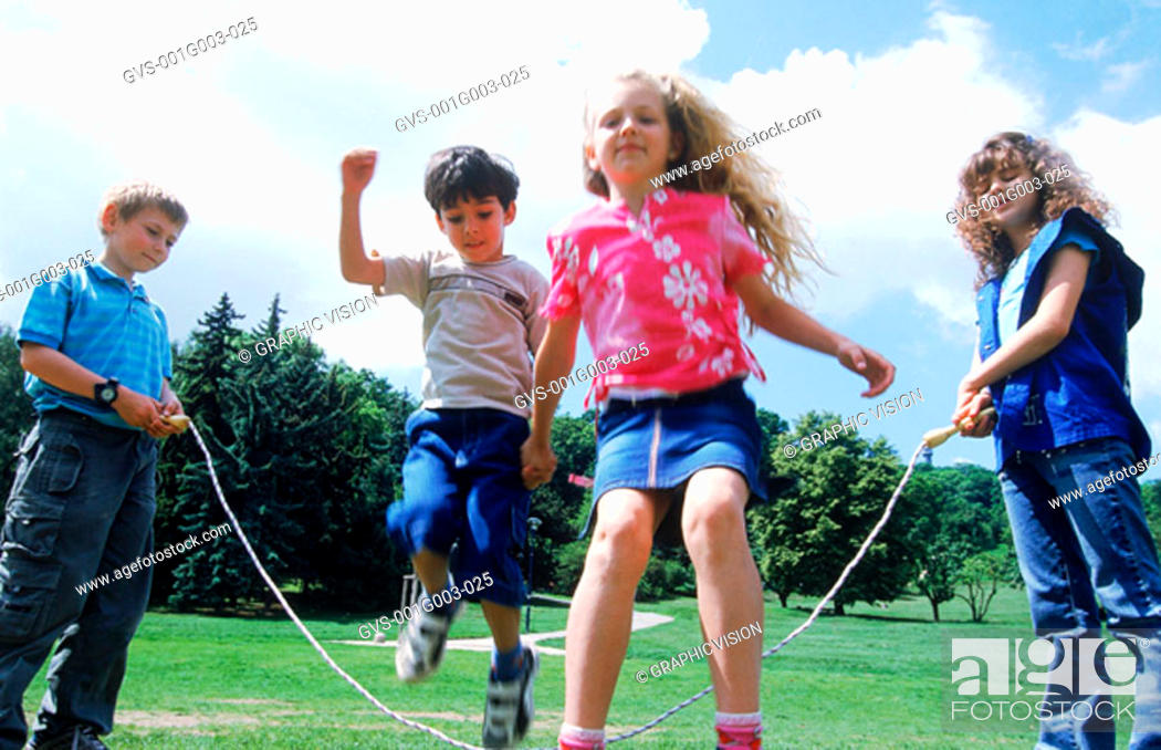 Stock Photo: Young children skipping in the park.