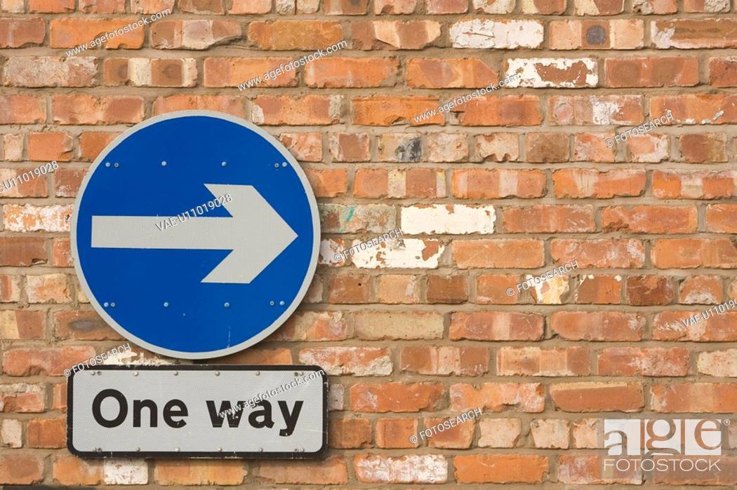 Stock Photo: Blue, Close-Up, Circle, Brick Wall, Arrow Sign.
