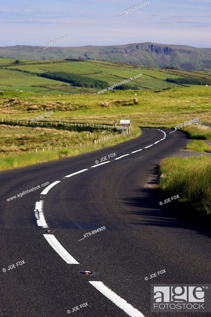 Stock Photo: twisty bendy antrim coastal road route over mountains on the antrim plateau county antrim northern ireland uk.