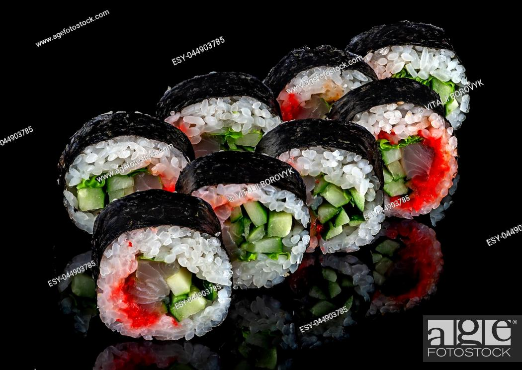 Stock Photo: Some of rolls spicy lollo-ross in two rows on a black background with reflection.