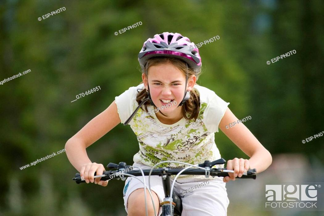 Stock Photo: Young girl riding bicycle.
