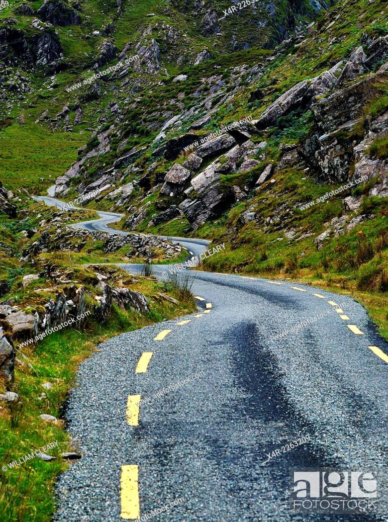 Stock Photo: Narrow road winding through the Ballaghbeama Gap, County Kerry, Ireland.