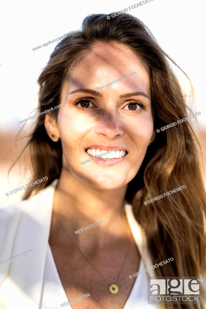 Stock Photo: Portrait of smiling businesswoman outdoors.