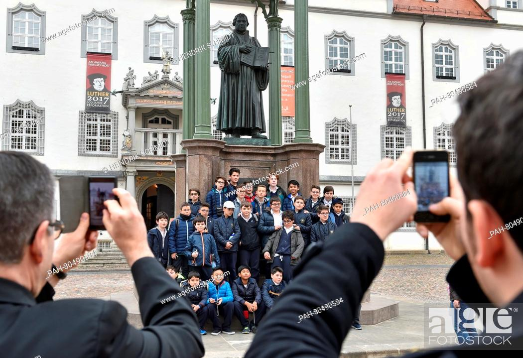 Stock Photo: The boys of the Sistine Chapel Choirpose for a group picture at the Martin Luther memorial on a tour throughWittenberg, Germany, 18 May 2016.