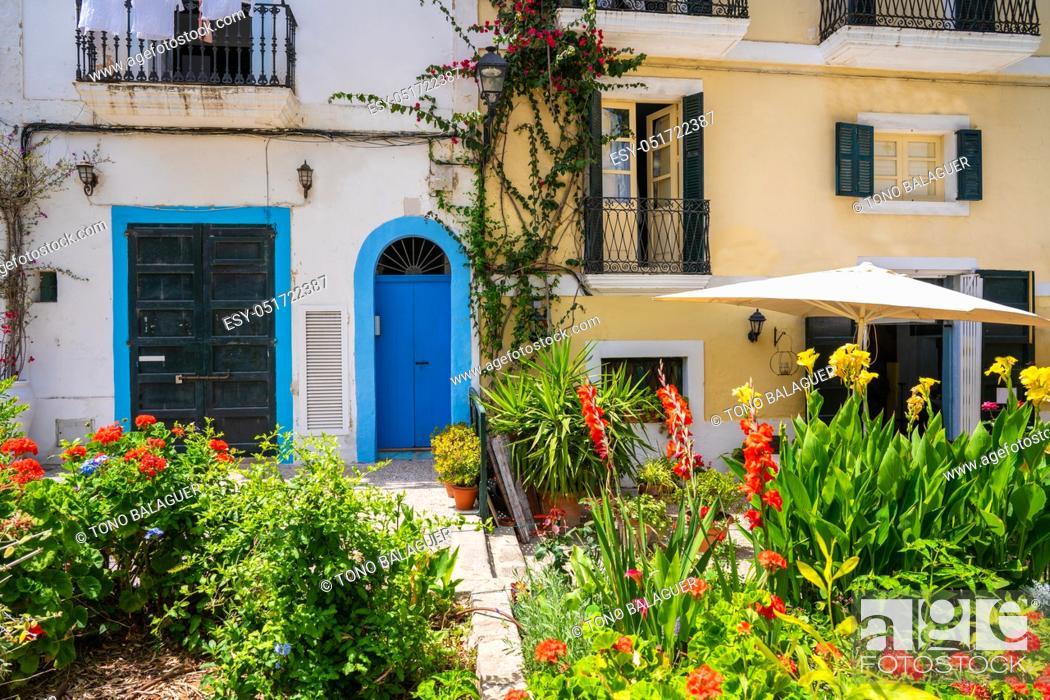 Photo de stock: Ibiza Eivissa downtown Dalt Vila flower facades in Balearic Islands.