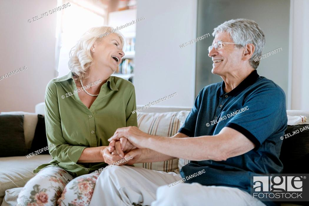 Stock Photo: Happy senior couple at home.