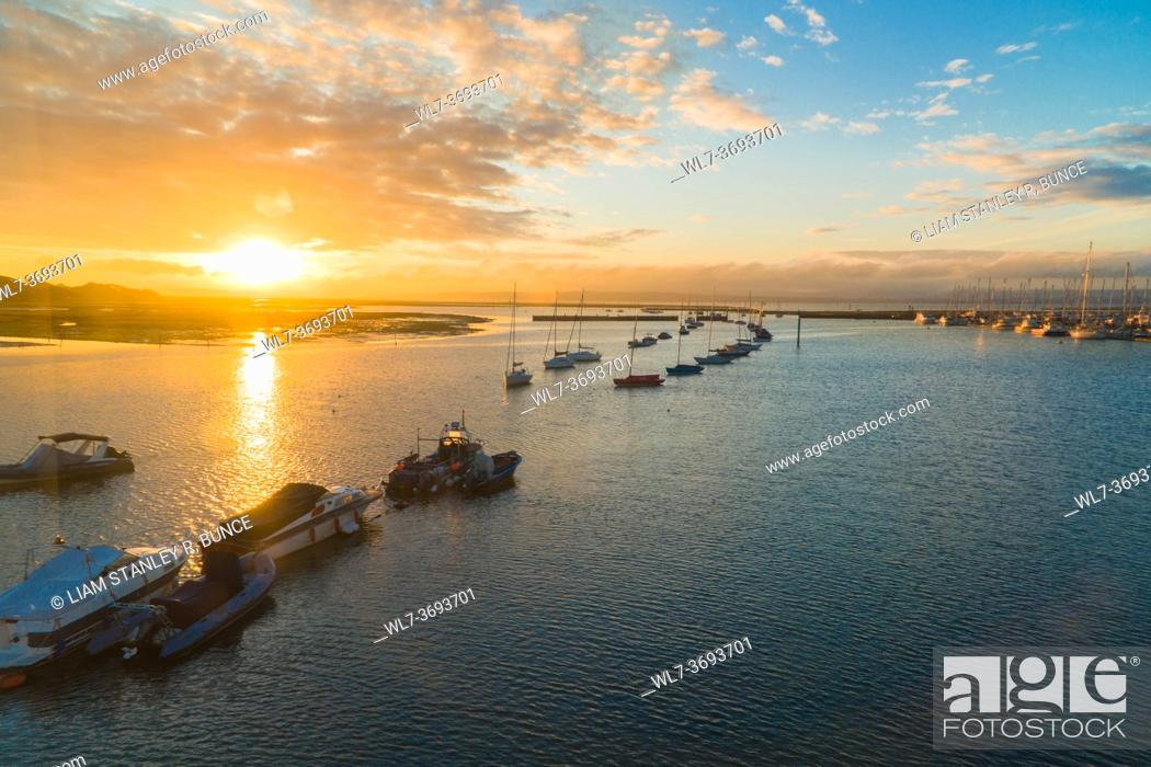 Stock Photo: Sunrise over Lymington harbour taken from ferry, Hampshire UK. October 2020.