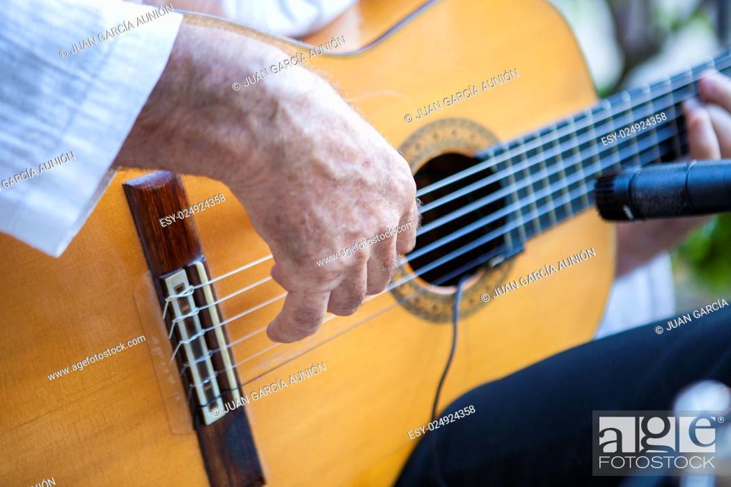 Stock Photo: Spanish flamenco guitarist playing. Selective focus on hand.