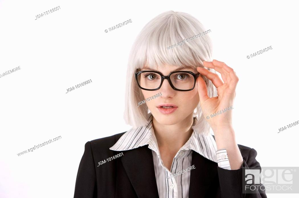 Stock Photo: Young businesswoman wearing glasses.