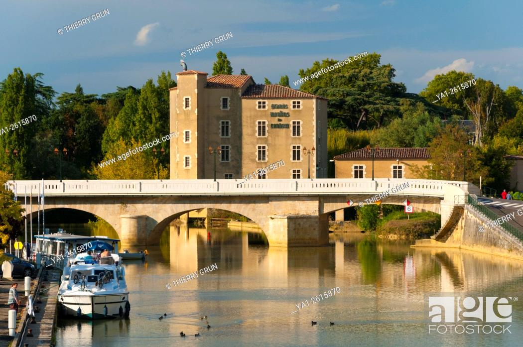 Stock Photo: France, Gers (32), Town of Condom, old water mills on La Baise river and Barlet bridge.