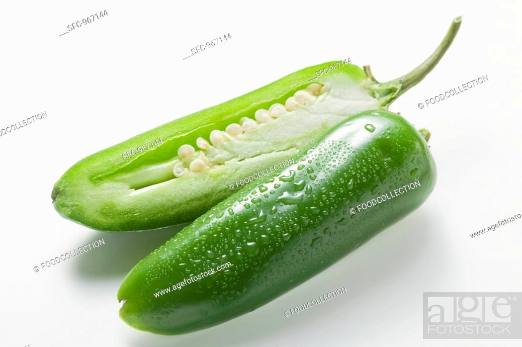 Stock Photo: Green chilli with drops of water, halved.
