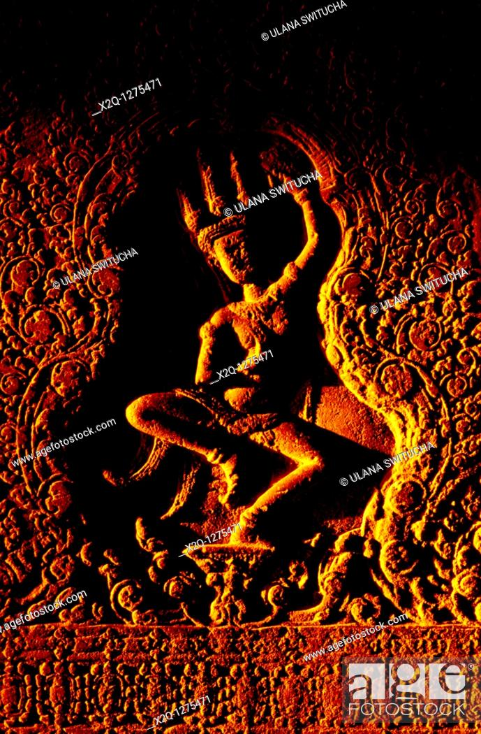 Stock Photo: An Apsara, angelic beings carved in the galleries of Angkor Wat, Cambodia.