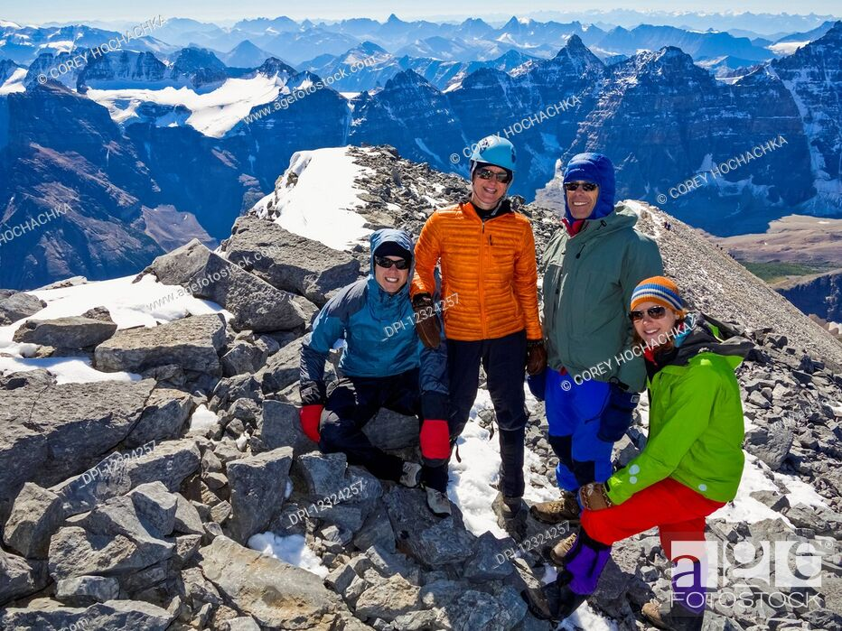Stock Photo: A family posing while hiking in the Rocky Mountains; Banff, Alberta, Canada.