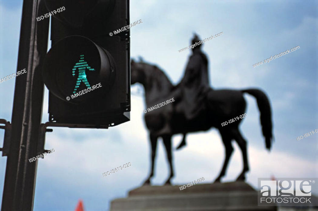 Stock Photo: Pedestrian crossing and statue.