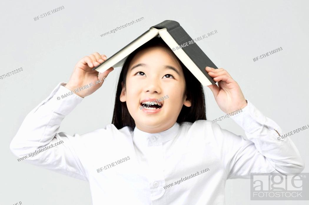 Stock Photo: girl holding a book.