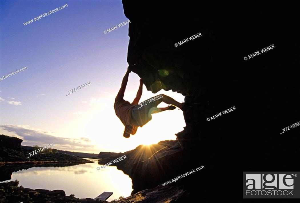 Stock Photo: Man rock climbing bouldering The Overhang at Dierkes Lake Park in the Snake River Canyon near the city of Twin Falls Idaho USA.
