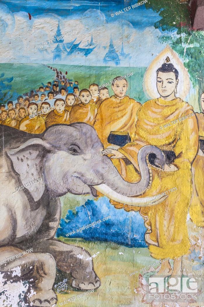 Imagen: Laos, Luang Prabang, Wat Punluang, paintings of Buddha.