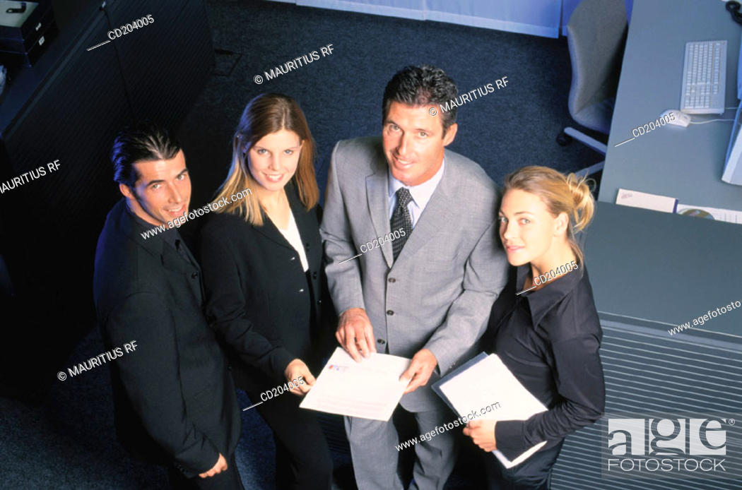 Stock Photo: Four businesspeople with files looking at camera.