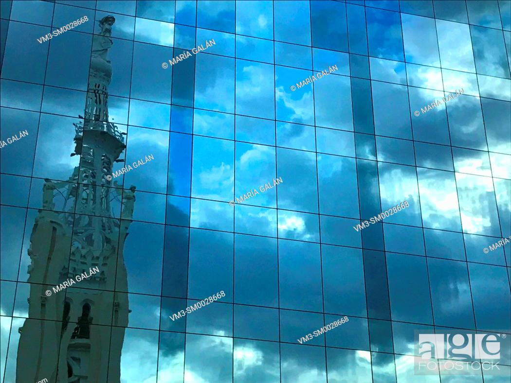 Stock Photo: Bell tower and sky reflected on glass facade. Goya street, Madrid, Spain.