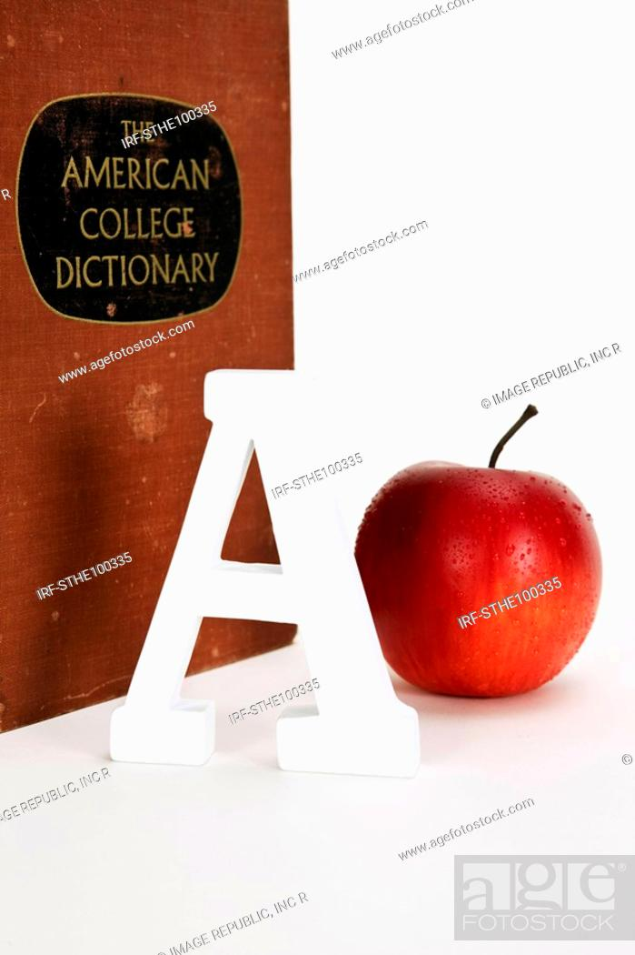 Stock Photo: apple, A and dictionary.