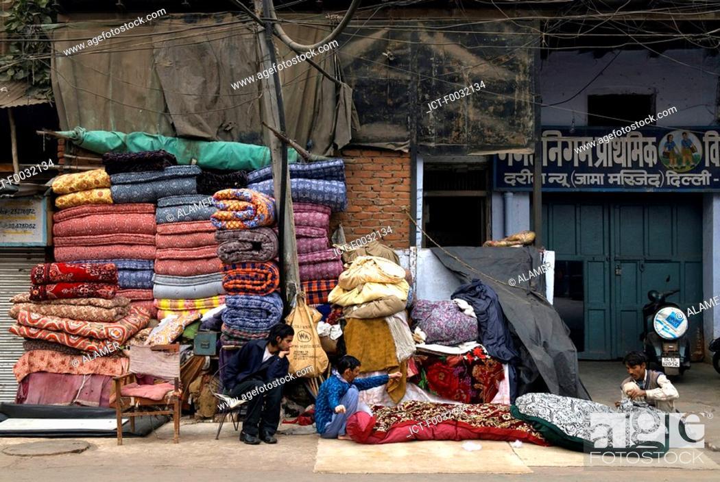 Stock Photo: India, New Delhi, mattress dealer near the Jama Masjid.