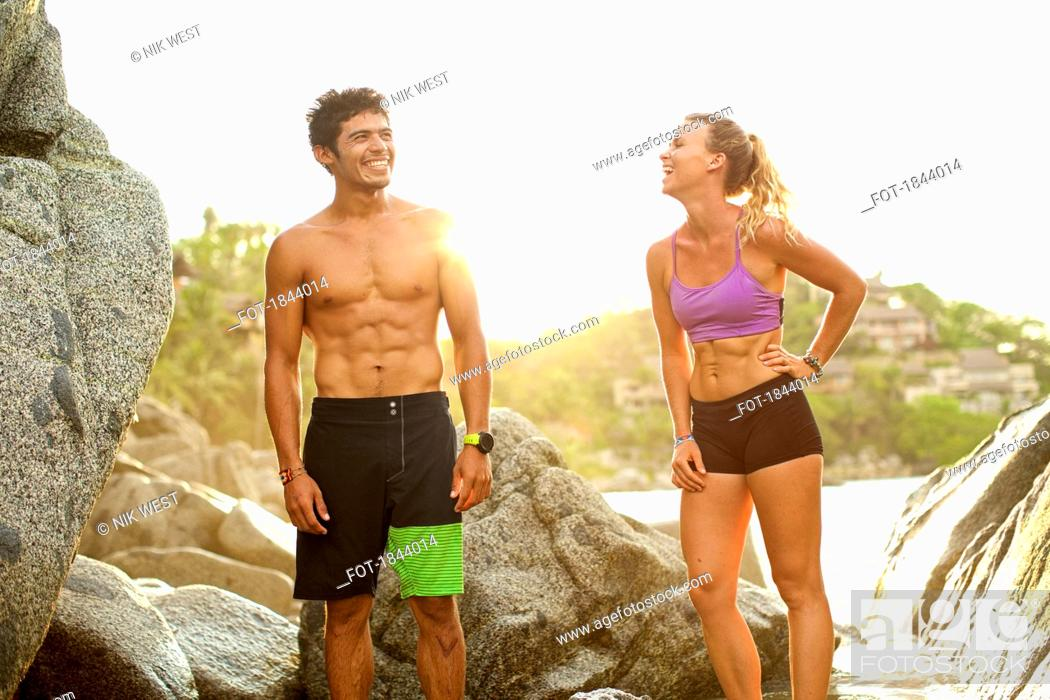 Imagen: Young, fit couple laughing on beach, Sayulita, Nayarit, Mexico.