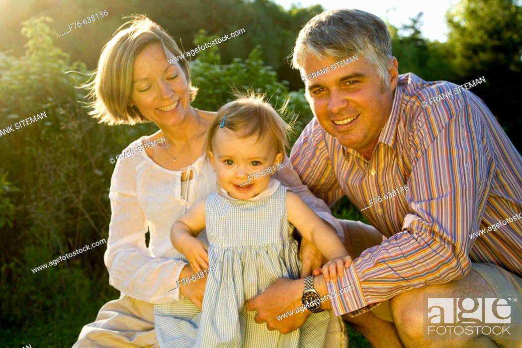 Stock Photo: Parents with one year old daughter.
