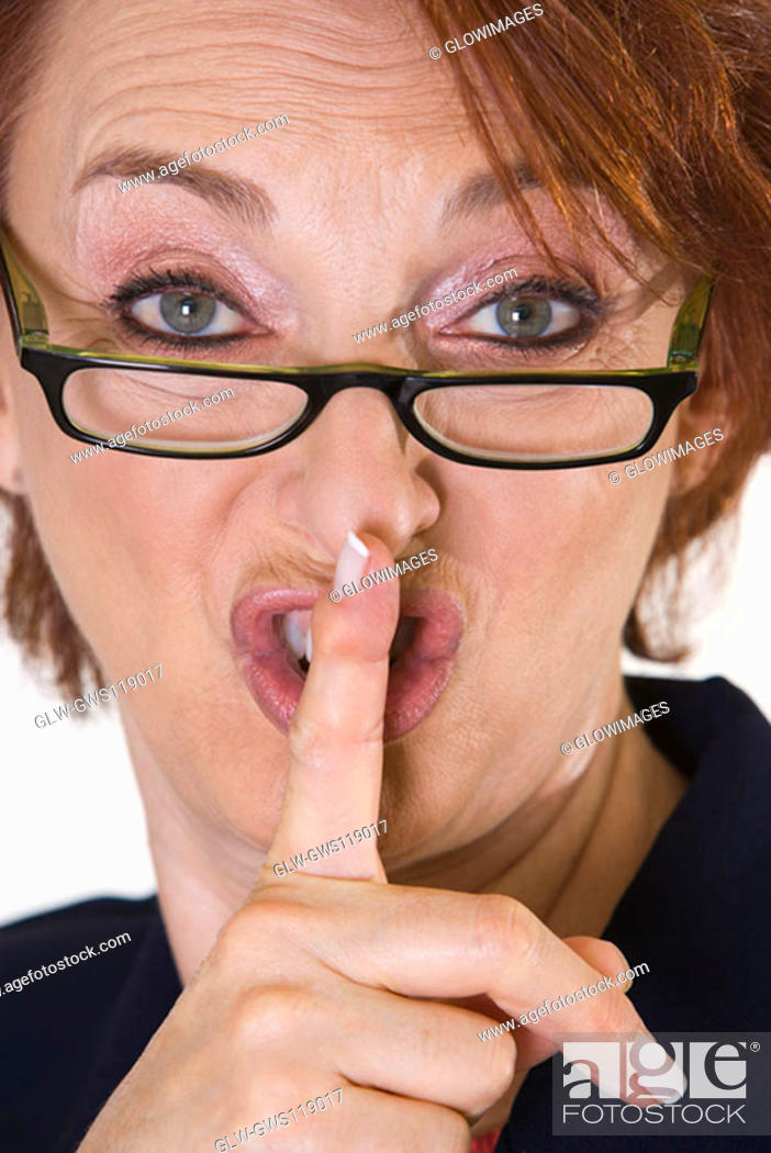 Stock Photo: Portrait of a businesswoman with her finger on her lips.