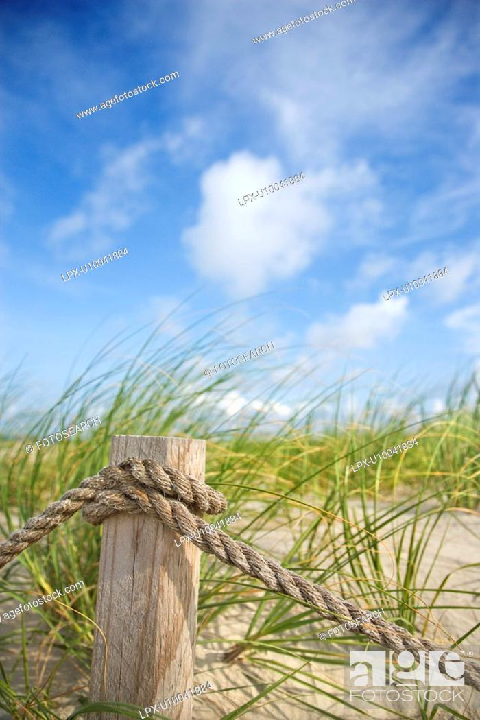 Stock Photo: Rope fence barrier on beach.