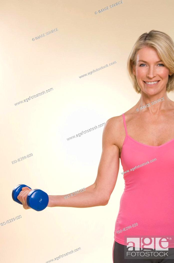 Stock Photo: A woman lifting dumbbells.