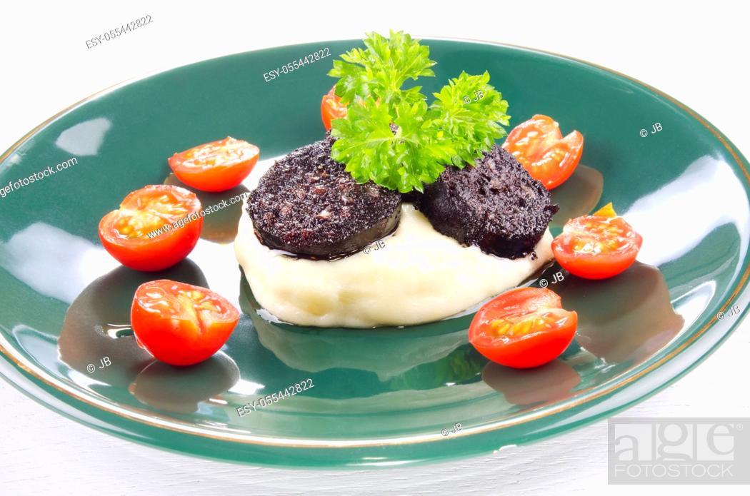 Stock Photo: mashed potatoes, black pudding, english cuisine.