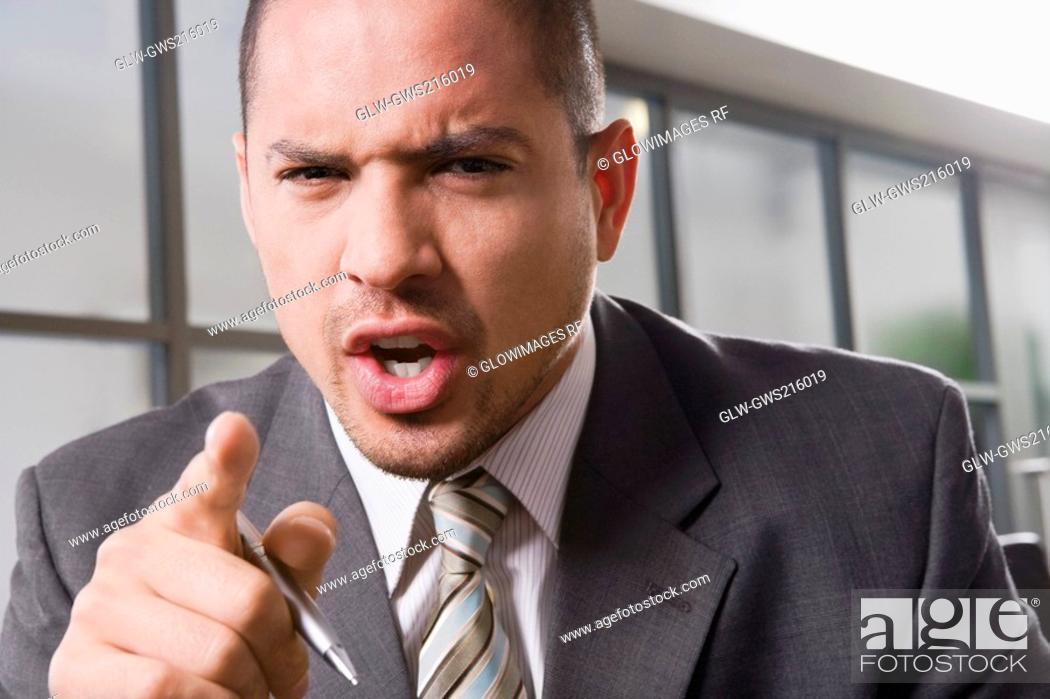 Stock Photo: Portrait of a businessman shouting.