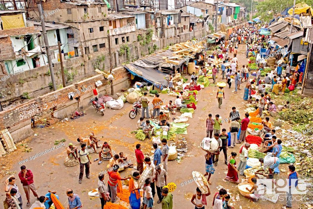 Stock Photo: Mullick bazaar flower market scene from the Howrah Bridge ; Kolkata or Calcutta ; West Bengal ; India.