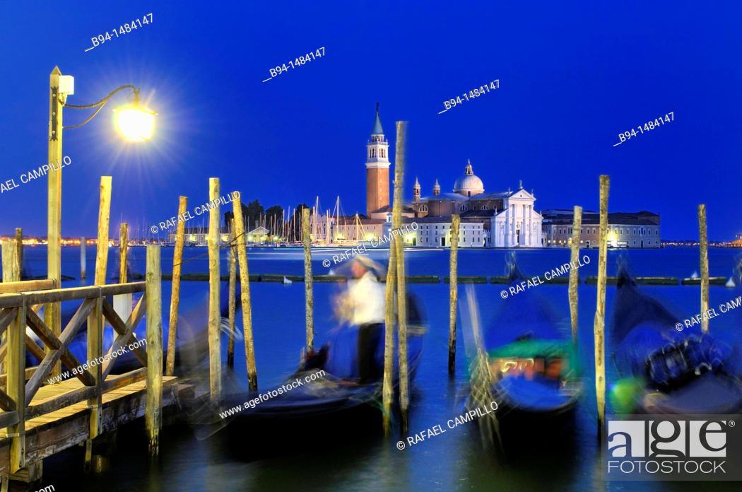 Stock Photo: Gondolas and gondolier from Riva degli Schiavoni with San Giorgio Maggiore island in background, Venice, Veneto, Italy.