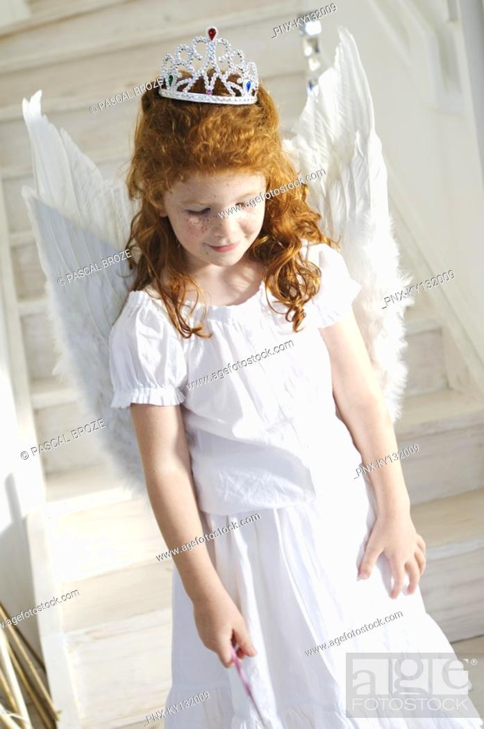 Stock Photo: Little girl in an angel costume, indoors.
