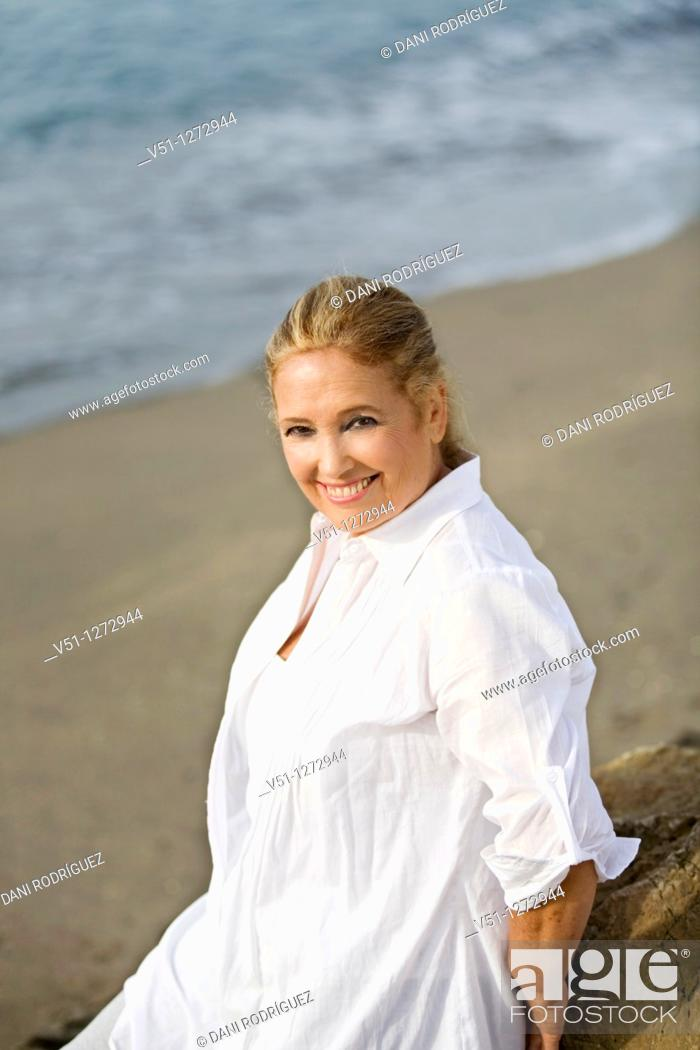 Stock Photo: Portrait of a senior adult woman at the beach.