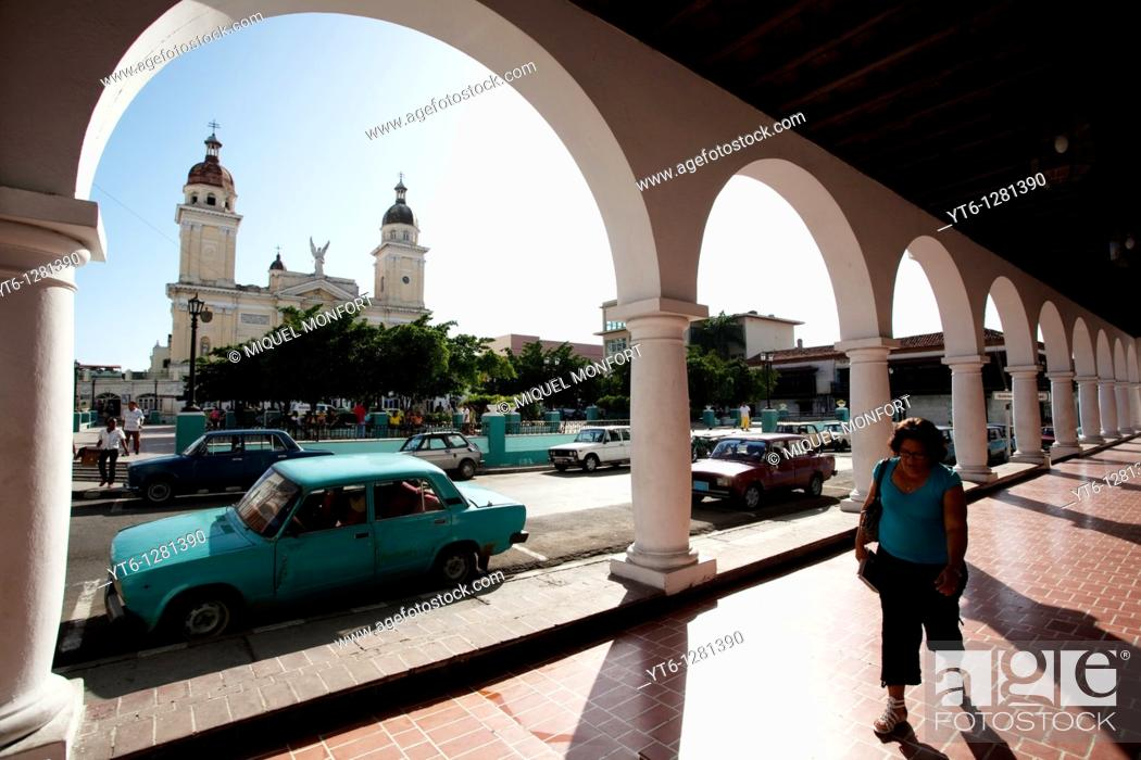 Stock Photo: Porch in the Park Céspedes, in the background there is the cathedral of Santiago of Cuba, Cuba, 2010.