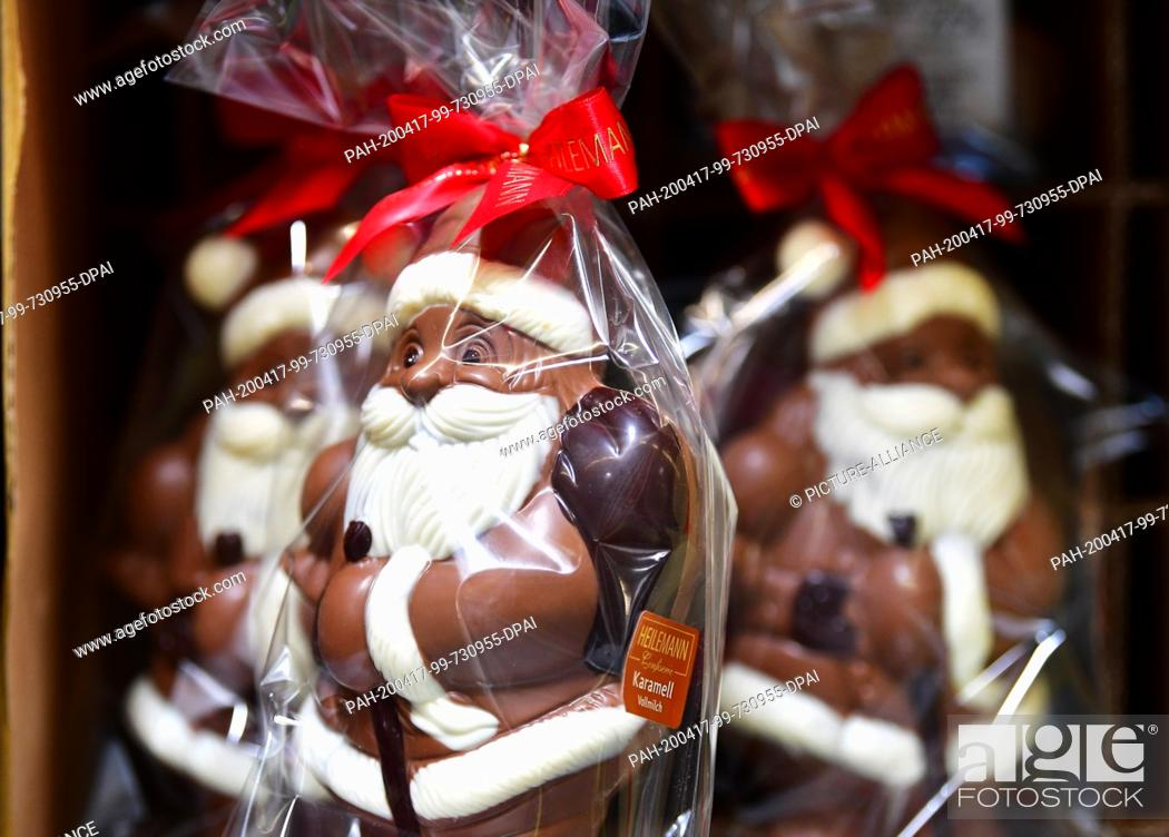 Stock Photo: 16 April 2020, Brandenburg, Großbeeren: Chocolate Father Christmases wrapped in plastic foil are available at the logistics service provider Rhenus Warehousing.