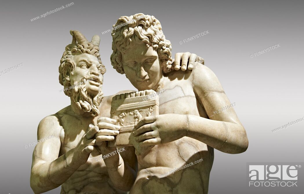 Stock Photo: 2nd century AD Roman marble sculpture of Pan teaching Daphnis to play the pipes, a Roman copy late 2nd century BC Hellenistic Geek original attributed to Rodes.