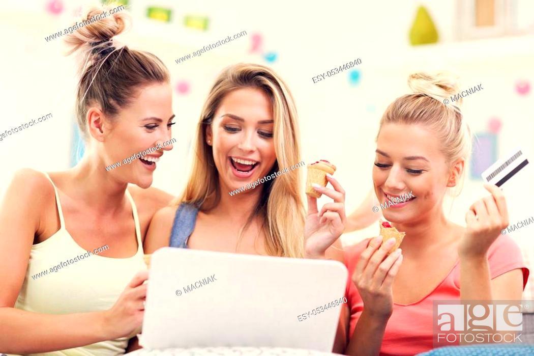 Stock Photo: Picture of three beautiful young women chilling at home.