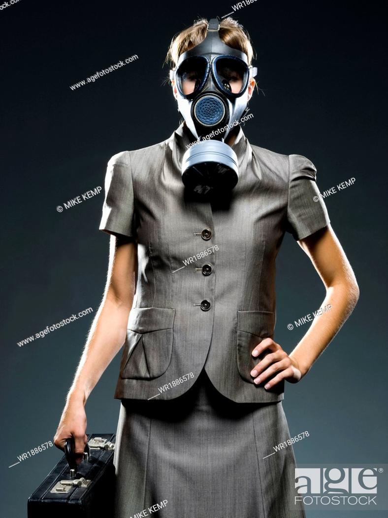 Stock Photo: businesswoman wearing a gas mask.