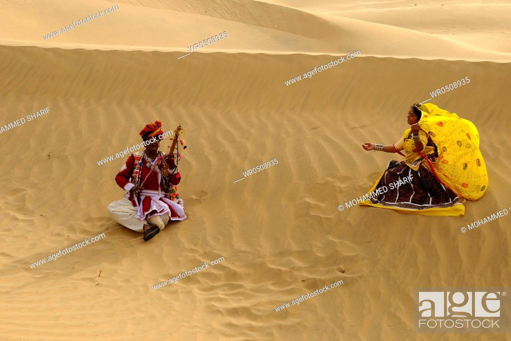Stock Photo: Couple playing folk music and dancer in sand dunes , Jaisalmer , Rajasthan , India MR769A.