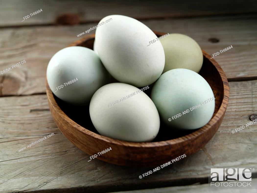 Stock Photo: A bowl of blues free range eggs.
