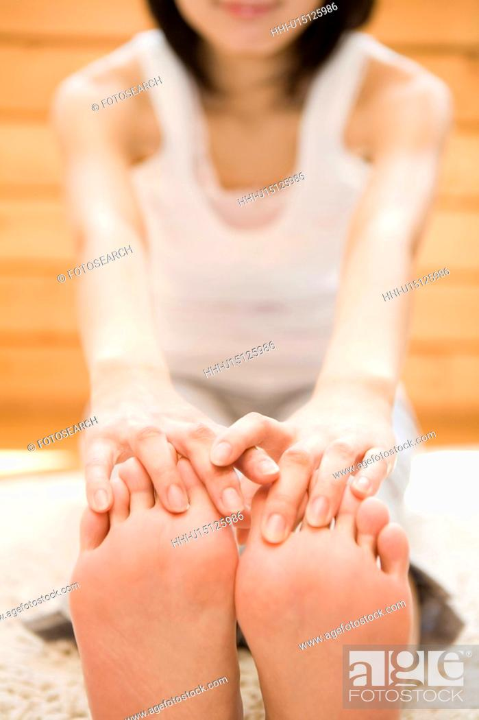 Stock Photo: Woman stretching herself.