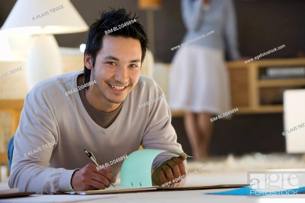 Stock Photo: Asian businessman working on floor.